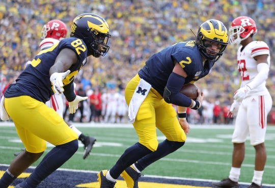 Michigan tight end Nick Eubanks, left, and quarterback Shea Patterson celebrate a touchdown during the first half of U-M's 52-0 win vs. Rutgers, Saturday, Sept. 28, 2019, at Michigan Stadium.