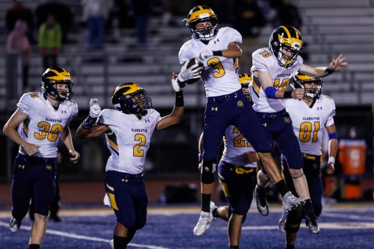 Clarkston safety Alec Boan (3) celebrates with teammates after intercepts the ball to seal the win against Oxford at Oxford High School in Oxford, Friday, Sept. 27, 2019.
