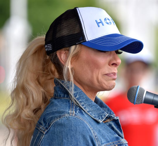 Fox 2 News anchor Amy Andrews becomes emotional as she addresses walkers about co-worker, meteorologist Jessica Starr, who died by suicide.