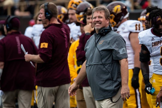 Central Michigan coach Jim McElwain watches Saturday's game from the sidelines.