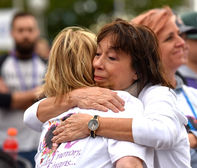 Jan Simpson, right, of Taylor, hugs Jane Tranter, of Bloomfield Hills. They lost their niece Gabby Garzoni.