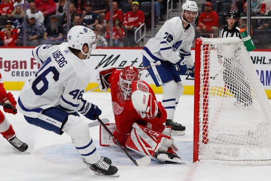 Red Wings goaltender Jonathan Bernier (45) deflects a shot by Maple Leafs left wing Pontus Aberg (46) during the second period on Friday.