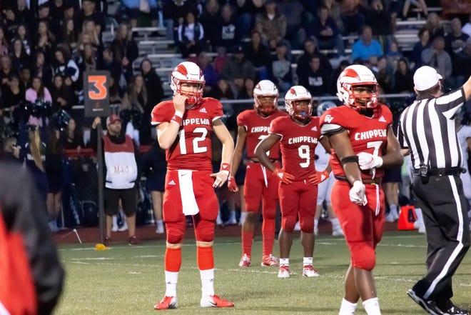 Chippewa Valley senior quarterback Josh Kulka receives the play from coach Scott Merchant.
