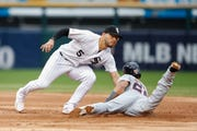 Chicago White Sox's Yolmer Sanchez, left, tags out at second base Detroit Tigers' Victor Reyes, right, during the third inning on Saturday.