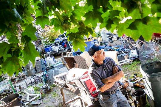 Bill Peterson, owner of Trailer Trash, talks at his trash hauling and recycling business he operates out of his Grand Rapids home on Wednesday, Sept. 18, 2019. Peterson, who says it's his calling in life to take care of trash, is fighting against the city for zoning violations.
