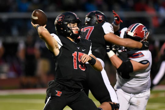 Livonia Churchill quarterback Gavin Brooks passes against Livonia Franklin in the first quarter on Friday.