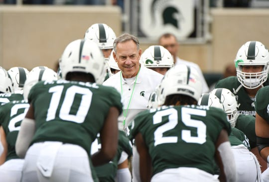 Michigan State coach Mark Dantonio and the Spartans will look to snap a three-game losing streak against Ohio State on Saturday.