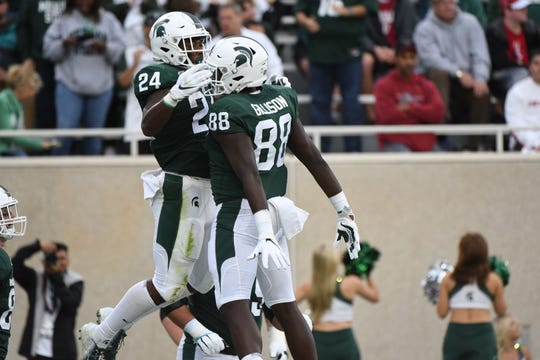 The Spartans celebrate a first-quarter touchdown against Indiana.