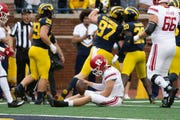 Rutgers quarterback Artur Sitkowski sits on the turf after failing to convert on a fourth-and-3 in the second quarter.