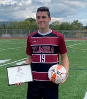 Noah Sperduto holds a commemorative plaque and signed ball after becoming the top goal scorer in Elmira Express boys soccer history Sept. 28, 2019 in a 6-0 win over Waverly at Ernie Davis Academy.