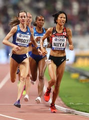 Hitomi Niiya of Japan and Elmira native Molly Huddle compete in the Women's 10,000 meters final at the IAAF World Championships at Khalifa International Stadium on September 28, 2019 in Doha, Qatar.