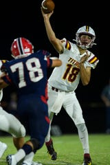 Gibson Southern's Brady Allen (19) attempts to make a pass during the first quarter against the Heritage Hills Patriots at Patriot Field in Lincoln City, Ind., Friday night, Sept. 27, 2019.