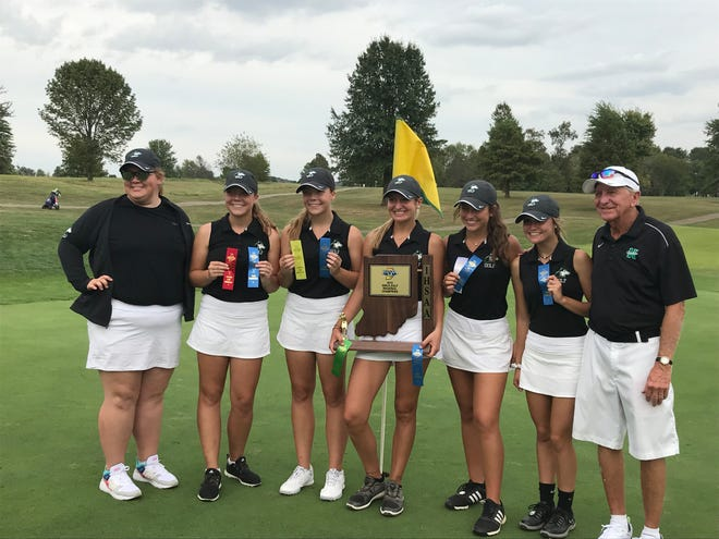 The North girls golf team celebrates a regional championship. The Huskies broke the state record with a 284.