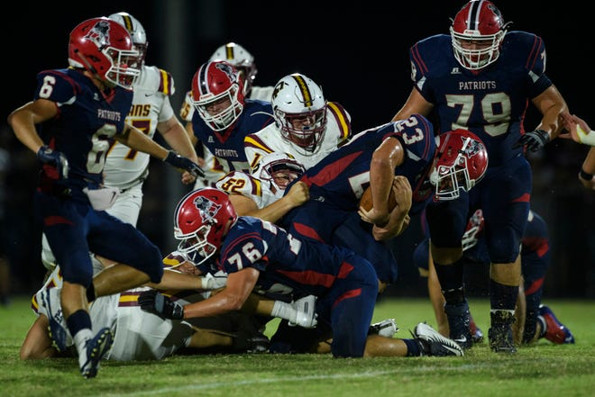 Heritage Hills' Phoenix Rodgers (23) pushes his way into first down against the Gibson Southern Titans in the first quarter at Patriot Field in Lincoln City, Ind., Friday night, Sept. 27, 2019.