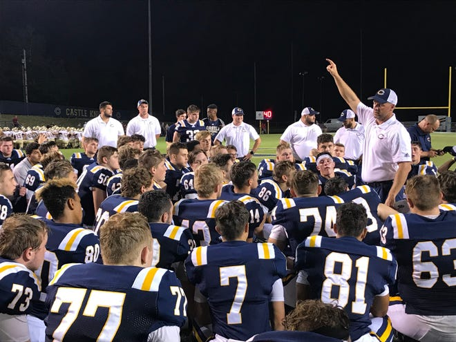 Castle coach Doug Hurt enthusiastically addresses his players after a 13-0 victory over Mater Dei in 2019.