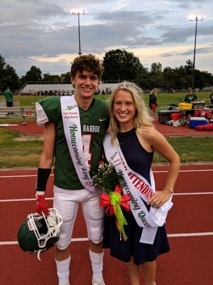 Oak Harbor homecoming king, Tyler May, and queen, Julie Young, were crowned at he homecoming game Friday night.