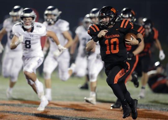 West De Pere quarterback Josh Blount runs past the Menasha defense for a touchdown on Friday.