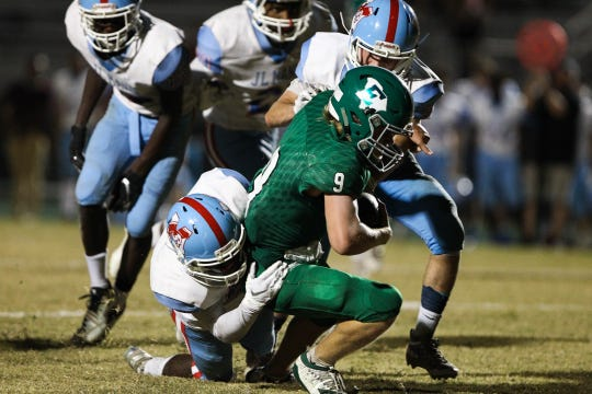 Easley's Josh Hill (33) is tackled by J.L. Mann players in Upstate SC high school football week 5, Friday, Sept. 27, 2019.
