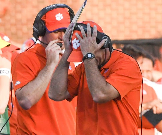 Clemson Head Coach Dabo Swinney holds his head after a holding call against the Tigers during the third quarter at Kenan Memorial Stadium in Chapel Hill, North Carolina Saturday, September 28, 2019.