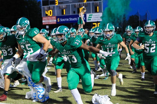 Easley's Josh Hill (33) runs with his teammates before Easley hosted J.L. Mann in Upstate SC high school football week 5, Friday, Sept. 27, 2019.