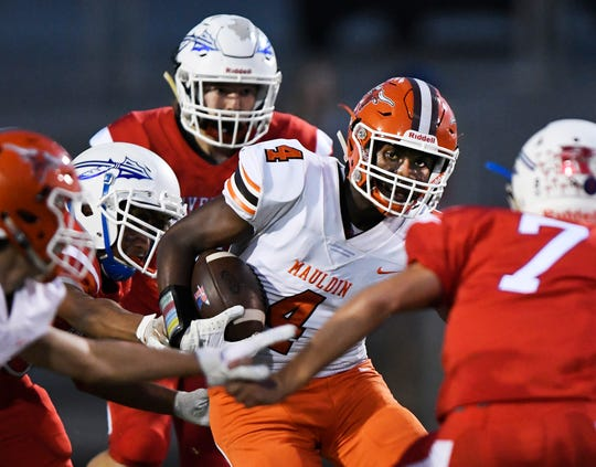 Mauldin's Randy Caldwell (4) tries to escape the Riverside defense Friday, September 27, 2019, at The Reservation.