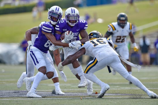 Furman's Devin Wynn (22) rushes for a first down during the first half of the ETSU game Saturday, Sept. 28, 2019.