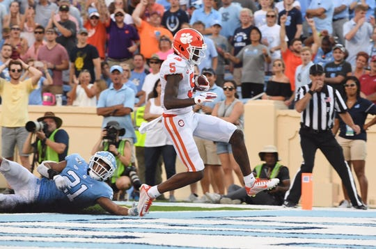 Clemson wide receiver Tee Higgins (5) scores a go-ahead touchdown in the fourth quarter against UNC on Saturday, Sept. 28, 2019.
