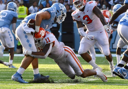 Clemson linebacker Isaiah Simmons sacks North Carolina quarterback Sam Howell during their game at Kenan Stadium.