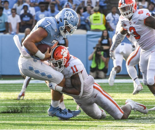 Clemson safety Isaiah Simmons (11) sacks North Carolina quarterback Sam Howell during the third quarter at Kenan Memorial Stadium in Chapel Hill, North Carolina Saturday, September 28, 2019.