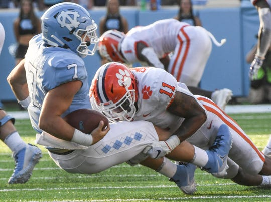 Clemson safety Isaiah Simmons (11) sacks North Carolina quarterback Sam Howell during the third quarter at Kenan Memorial Stadium in Chapel Hill, North Carolina Saturday, September 28, 2019.