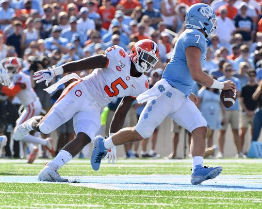 Clemson defensive end K.J. Henry (5) in pursuit of UNC quarterback Sam Howell on Saturday, Sept. 28, 2019.