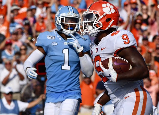 Clemson running back Travis Etienne (9) runs for a touchdown in the second quarter against UNC on Saturday, Sept. 28, 2019.