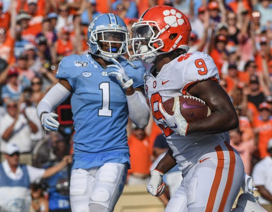 Clemson running back Travis Etienne (9) scores by North Carolina defensive back Myles Dorn during the second quarter  at Kenan Memorial Stadium in Chapel Hill, North Carolina Saturday, September 28, 2019.