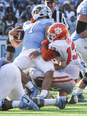 Clemson defensive lineman Tyler Davis(13) sacks North Carolina quarterback Sam Howell during the third quarter at Kenan Memorial Stadium in Chapel Hill, North Carolina Saturday, September 28, 2019.