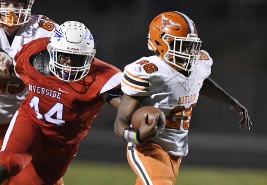 Mauldin's Jordon Franklin (26) gets away from Riverside's Rickey Abercrombie (44) Friday at The Reservation.
