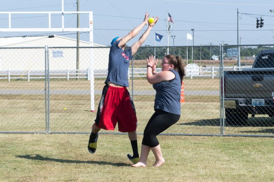 Jaquan Dixon, left, and Melissa Couturiaux, right collide as they go for a pop fly during the Henderson Wiffle Ball Classic benefiting the Boys and Girls Club of Henderson at the Henderson County Fairgrounds Saturday afternoon, Sept. 28, 2019.