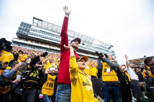Carson King and Reid Carver, 7, wave to patients in the Stead Family Children's Hospital after the first quarter during a NCAA non conference football game between the Iowa Hawkeyes and Middle Tennessee State, Saturday, Sept., 28, 2019, at Kinnick Stadium in Iowa City, Iowa.