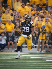 Iowa junior running back Toren Young runs the ball upfield against Middle Tennessee at Kinnick Stadium on Saturday, Sept. 28, 2019, in Iowa City.