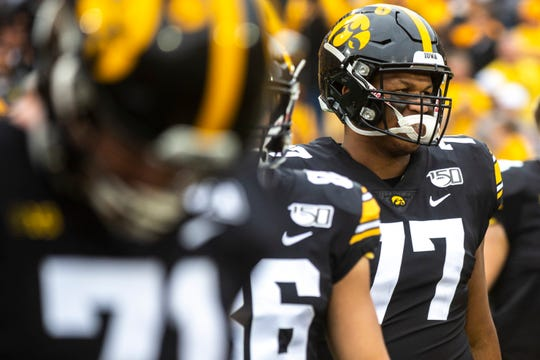 Iowa offensive lineman Alaric Jackson (77) walks across the field to meet with Middle Tennessee State players after a NCAA non conference football game between the Iowa Hawkeyes and Middle Tennessee State, Saturday, Sept., 28, 2019, at Kinnick Stadium in Iowa City, Iowa.