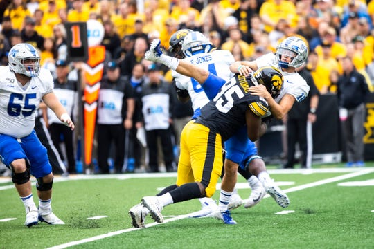 Being physical on both sides of the football is Iowa's best ticket to a Saturday win in the Big House. Here, defensive tackle Cedrick Lattimore sends an early message against Middle Tennessee State in a 48-3 Hawkeye win.