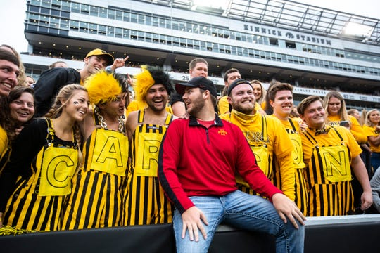 Carson King poses for a photo with Iowa students during a NCAA non conference football game between the Iowa Hawkeyes and Middle Tennessee State, Saturday, Sept., 28, 2019, at Kinnick Stadium in Iowa City, Iowa.