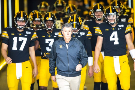 Iowa quarterbacks coach Ken O'Keefe walks down the tunnel with players before a NCAA non conference football game against Middle Tennessee State, Saturday, Sept., 28, 2019, at Kinnick Stadium in Iowa City, Iowa.