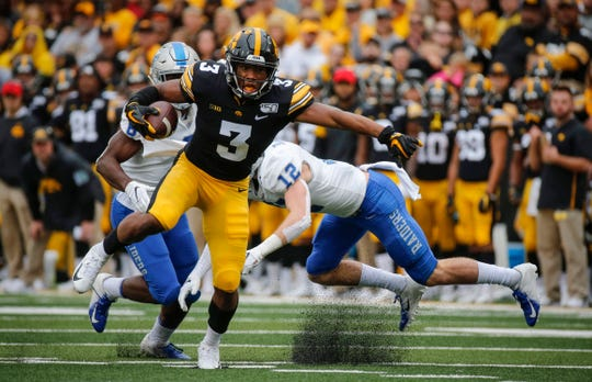 Iowa freshman wide receiver Tyrone Tracy eviscerates the Middle Tennessee secondary as he runs for a first down in the second quarter at Kinnick Stadium on Saturday, Sept. 28, 2019, in Iowa City.