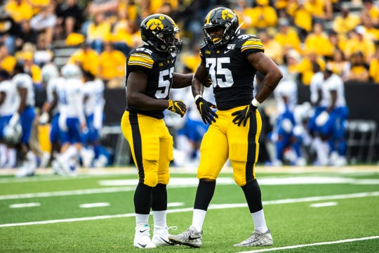 Iowa linebacker Amani Jones (52) comes to the side of Barrington Wade (35) after an attempted punt block during a NCAA non conference football game between the Iowa Hawkeyes and Middle Tennessee State, Saturday, Sept., 28, 2019, at Kinnick Stadium in Iowa City, Iowa.