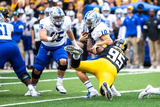 Iowa defensive lineman Cedrick Lattimore (95) sacks Middle Tennessee State quarterback Asher O'Hara (10) during a NCAA non conference football game between the Iowa Hawkeyes and Middle Tennessee State, Saturday, Sept., 28, 2019, at Kinnick Stadium in Iowa City, Iowa.