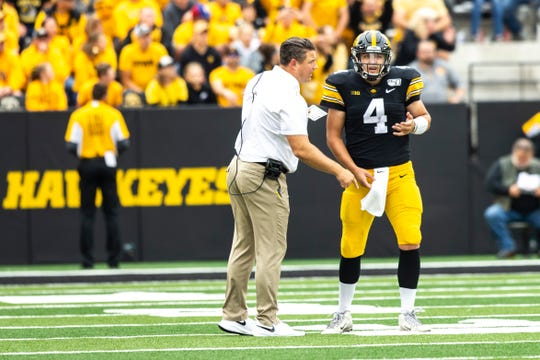 Iowa offensive coordinator Brian Ferentz, left, and quarterback Nate Stanley need to put a lot of points on the scoreboard Saturday against Purdue.