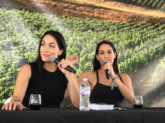 "Brie and Nikki Bella of the E! reality show ""Total Bellas"" talk about their Bella Radici wines at the 2019 IndyStar Wine & Food Experience Sept. 28  at Clay Terrace in Carmel."