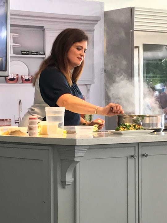 Food Network chef Alex Guarnaschelli prepares a corn salad during a cooking class at the 2019 IndyStar Wine & Food Experience Sept. 28 at Clay Terrace in Carmel.