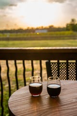 A glass of Spencer Farm Winery Blueberry wine and a glass of Farmhouse Red wine during the winery's soft opening on Friday, Sept. 27, 2019.