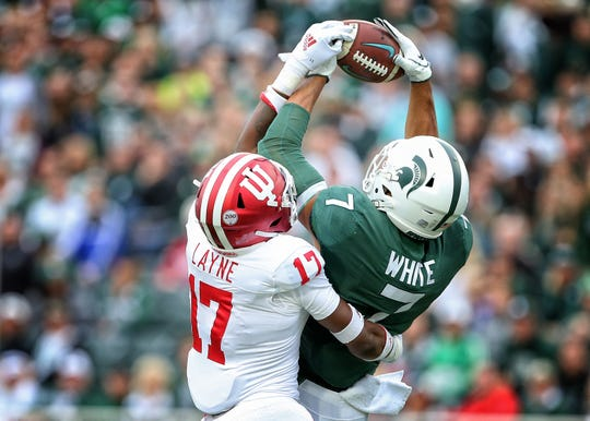 Michigan State Spartans wide receiver Cody White (7) is defended by Indiana Hoosiers defensive back Raheem Layne (17) during the first quarter of a game at Spartan Stadium.